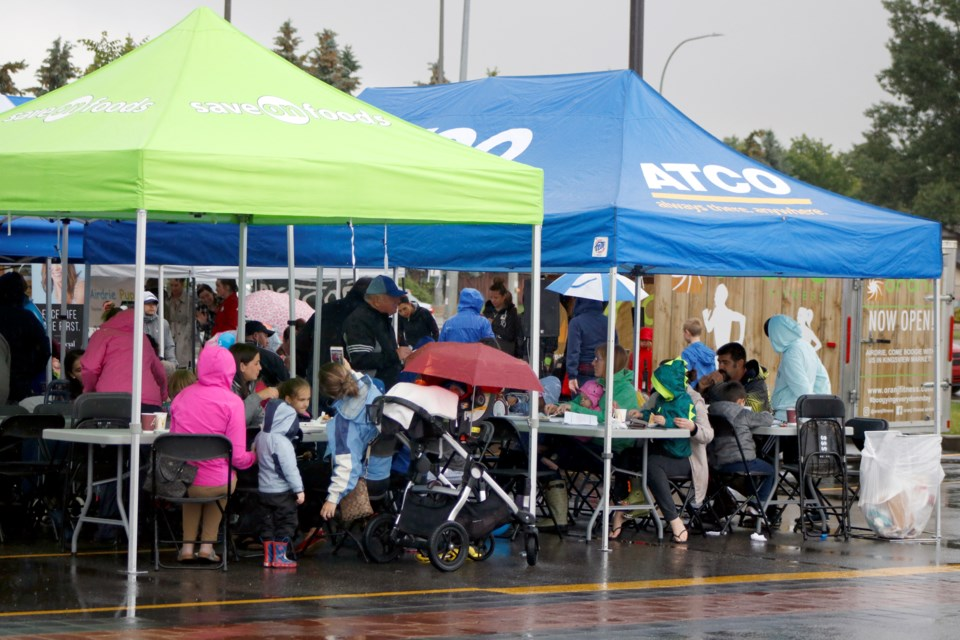 Kingsview Market held its annual Stampede Breakfast July 4. Those who braved the rain and cold enjoyed a full pancake breakfast. Photo by Nathan Woolridge/Rocky View Publishing