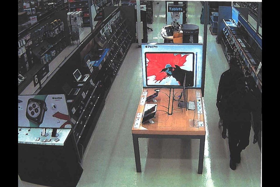 Airdrie RCMP is looking for these two men who are wanted in connection with a theft at the Staples on Main Street. Photo Submitted/For Rocky View Publishing