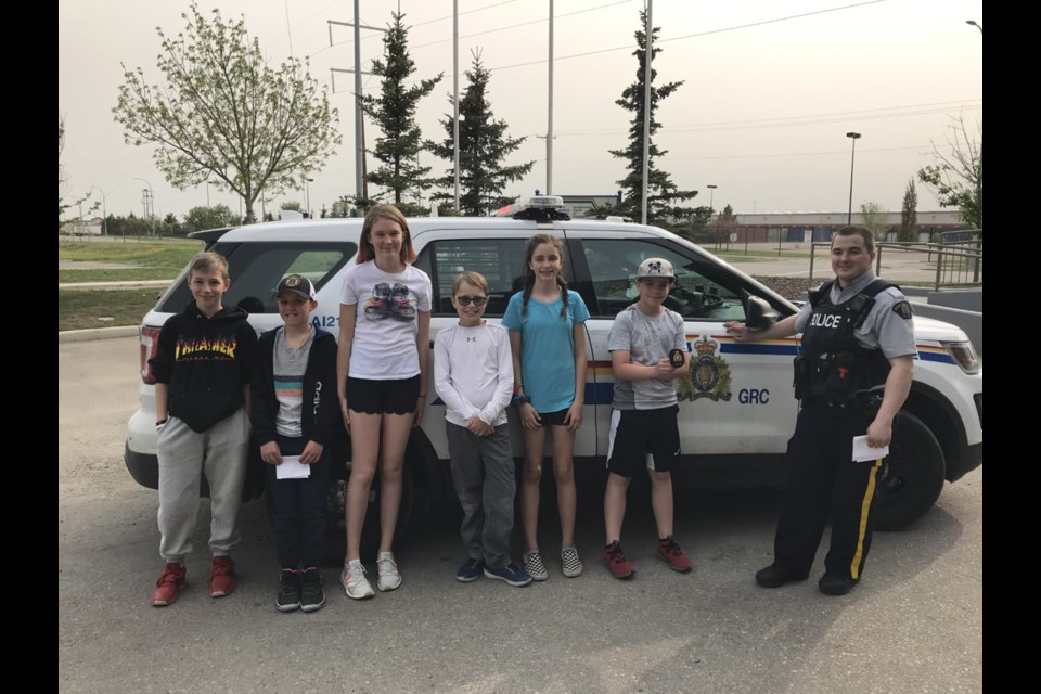 Six area students were chosen to participate in a new program with Airdrie RCMP called Cops for Kids. 