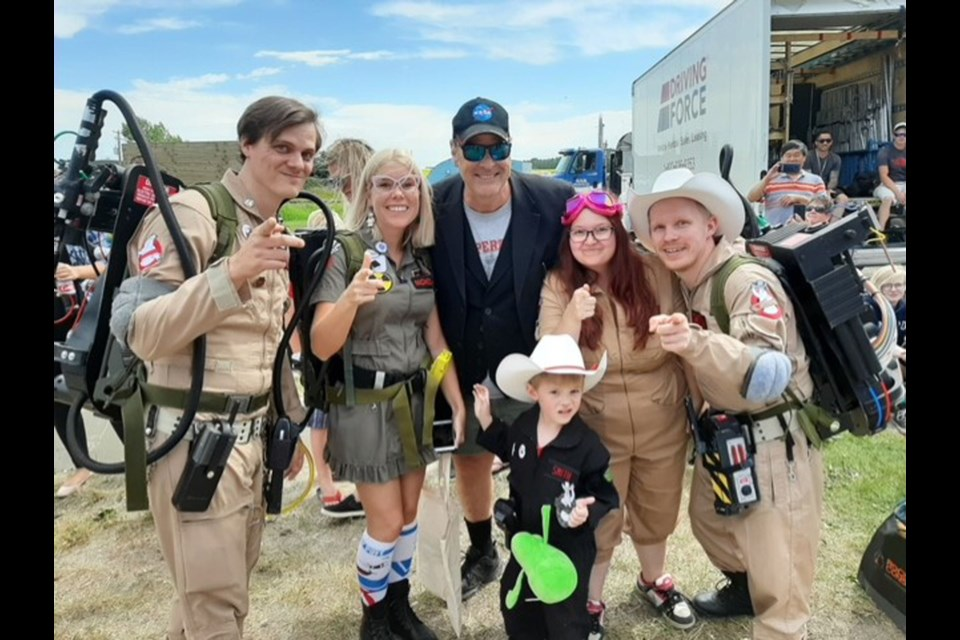 """The Calgary Ghostbusters met a familiar face in Crossfield near the set of the new """"Ghostbusters"""" 2020 film – original Ghostbusters actor Dan Aykroyd.  (Back row from left) Sean Nicholson, Candace Schneider, Aykroyd, Jessica Smith, Eldon Smith and Myrick Smith (Bottom).  Photo Submitted/For Rocky View Publishing"""
