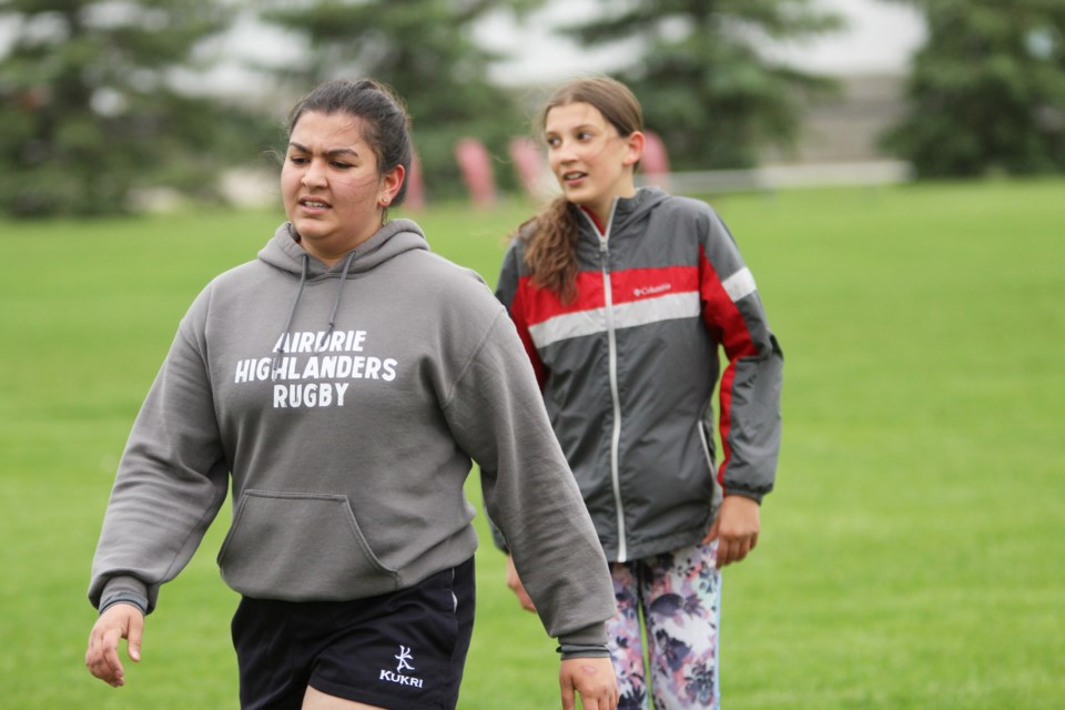 Members of the Airdrie Highlanders are preparing for the Stampede 7s rugby tournament, July 5 and 6 in Calgary. The club is holding twice-weekly training sessions on Tuesday and Thursday evenings.  Photo by Scott Strasser/Rocky View Publishing