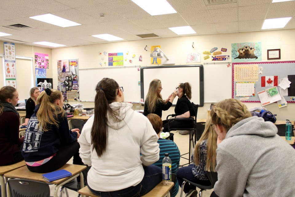 Cosmetology students at W.G. Murdoch High School in Crossfield learned from a pro May 2, during a stage makeup demonstration from Amanda Toszer. 