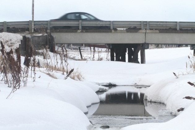 Nose Creek peeks through the snow Jan. 23 in Airdrie's northwest community of Stonegate. County council voted to provide more than $15,000 for the Nose Creek Water
