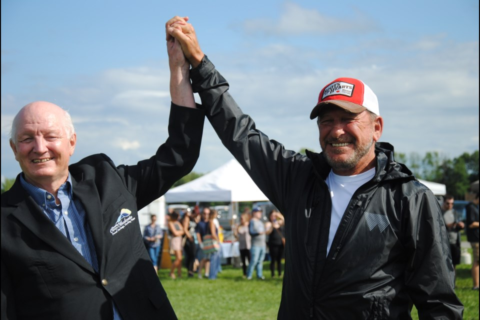 Oro-Medonte Mayor Harry Hughes and Republic Live founder Stan Dunford celebrate the end of a long OMB battle, just in time for the music to start later this month.