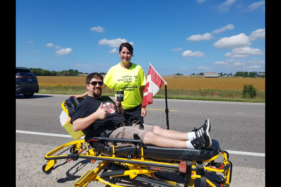 Shawn Gibson represented BarrieToday on the Paramedic push Friday, staying on the stretcher for 55 minutes and 4.5 km. Supplied photo
