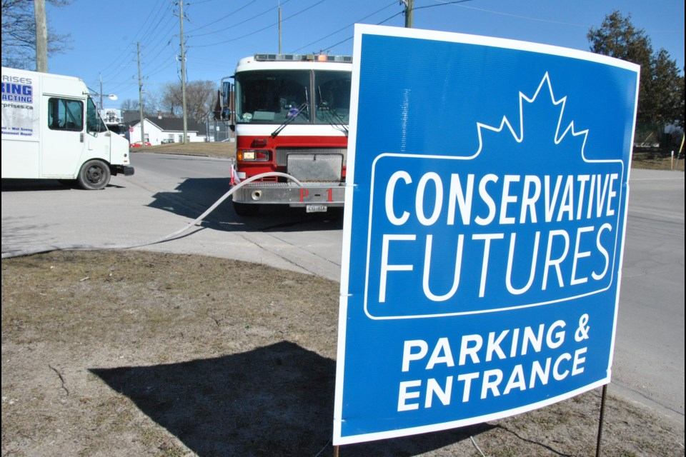 Barrie firefighters doused a car fire outside the warehouse where Conservative Futures attendees listened to Patrick Brown. Laurie Watt/BarrieToday