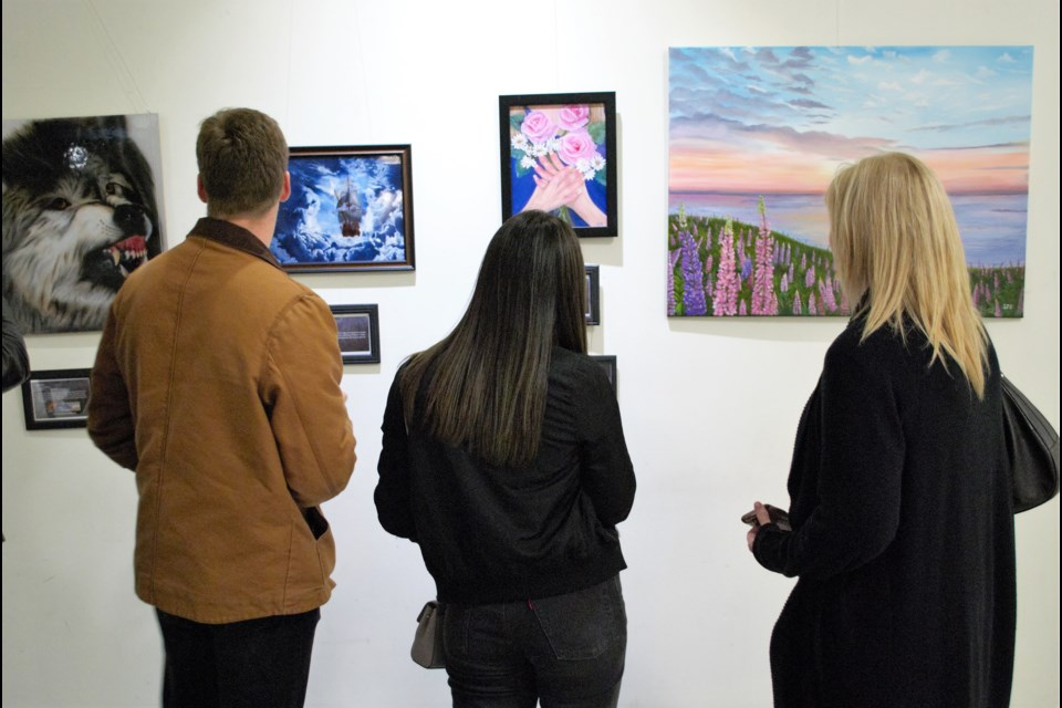 Patrons viewed the art on display at the opening reception for The Steel Spirit, a special art exhibit running at the Barrie city hall rotunda for the month of October. Jessica Owen/BarrieToday