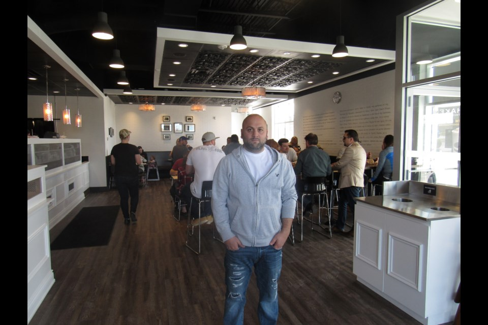 Shant Mardirosian recently opened The Burger's Priest in Barrie. Photo by Shawn Gibson for BarrieToday.