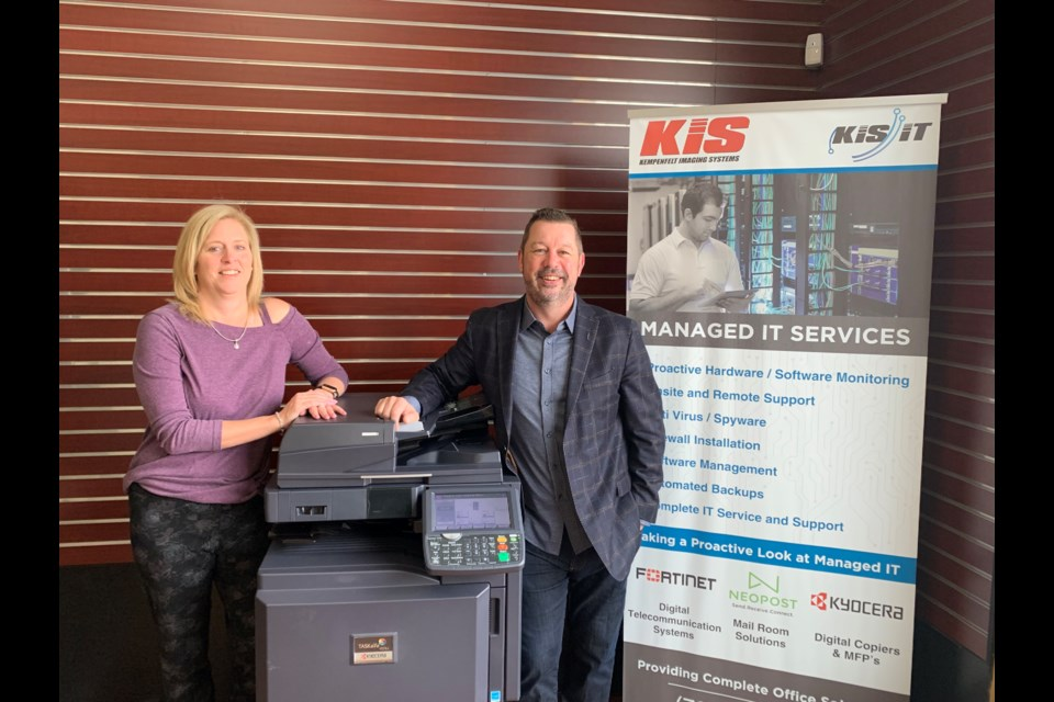 Kempenfelt Imaging Systems vice-president of finance Sheri Patfield, left, and owner Jody Patfield celebrate 20 years of business in Barrie. Submitted photo