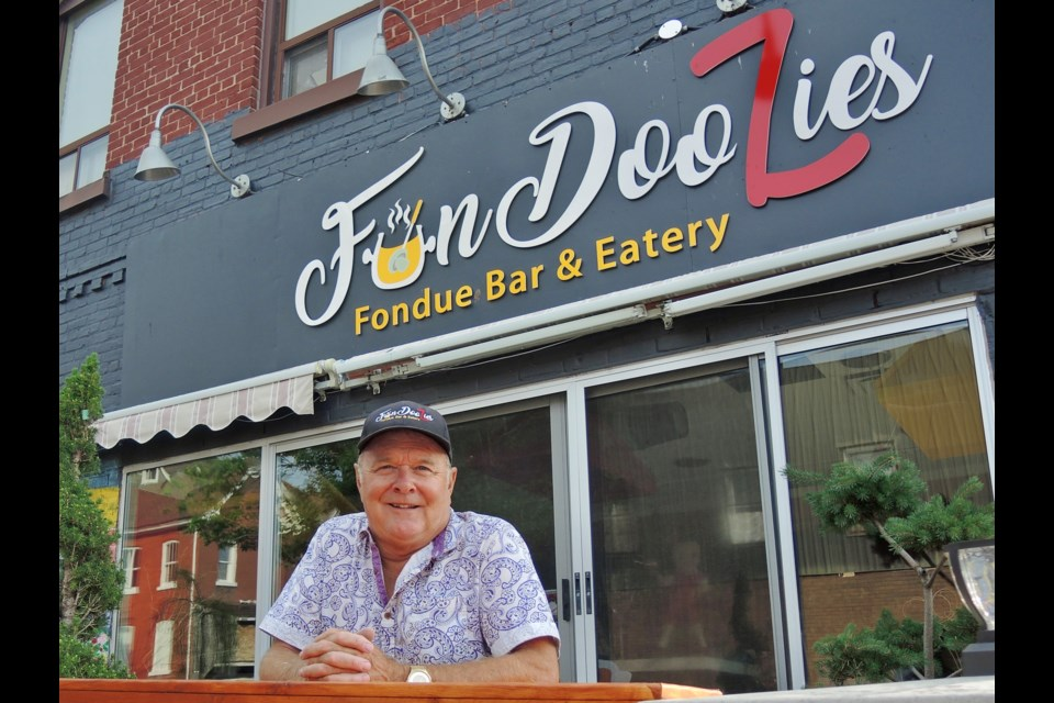 Entrepreneur and former executive Paul Phillips is opening FunDoozies Fondue Bar and Eatery in downtown Barrie.