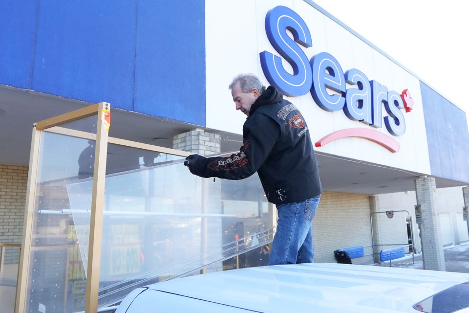 Flavio Ragazzon of Glencairn loads display cabinets onto his truck after buying them from the Sears store at Georgian Mall on Saturday, Jan. 13, 2018. It is the final weekend before the store closes its doors for good. Kevin Lamb for BarrieToday.