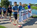 Hundreds 'Walk A Mile In Her Shoes'