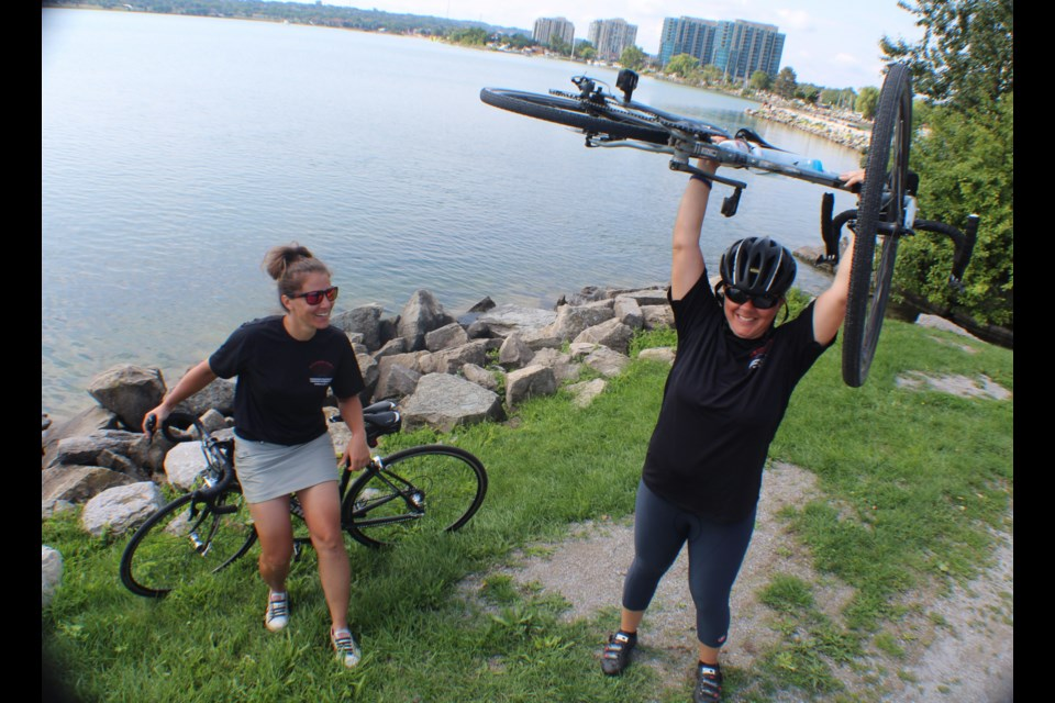 Julie Ann Chiodo, left, and Olivia Mendocino stopped in Barrie today for a quick rest at Heritage Park before continuing on toward Toronto. On July 8, they set out from Vancouver to raise money for the Canadian Pulmonary Fibrosis Foundation. Raymond Bowe/BarrieToday