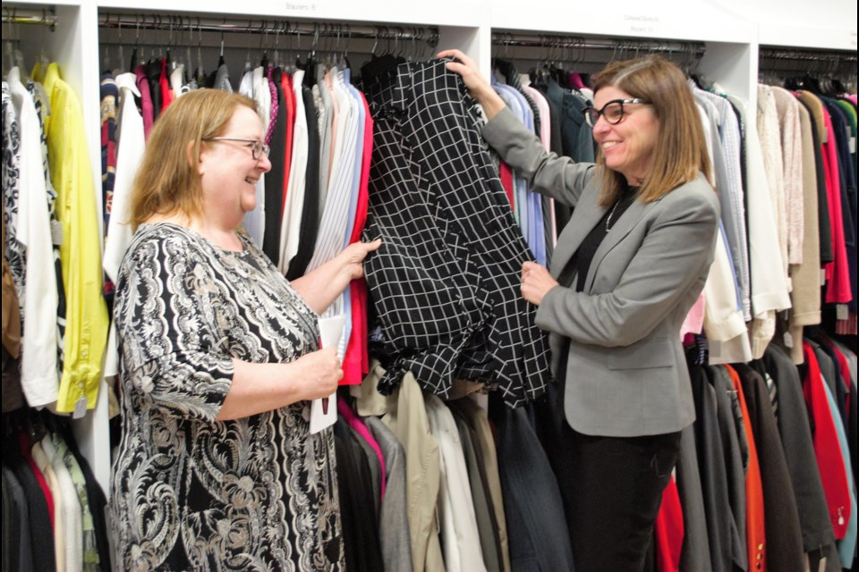 Linda Reid, executive director for Dress for Success Orillia and Barrie, gives a tour of the Barrie facility to the Honourable Filomena Tassi, Minister of Seniors. Jessica Owen/BarrieToday