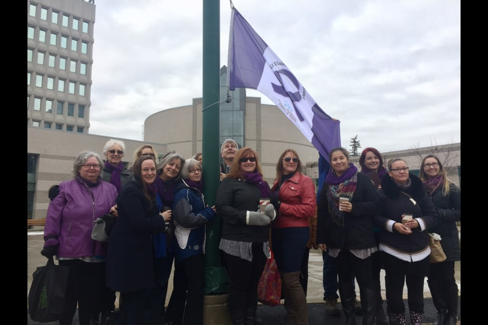 More than a dozen people were at City Hall Friday for a flag-raising for the Women and Children's Shelter of Barrie. Sue Sgambati/BarrieToday