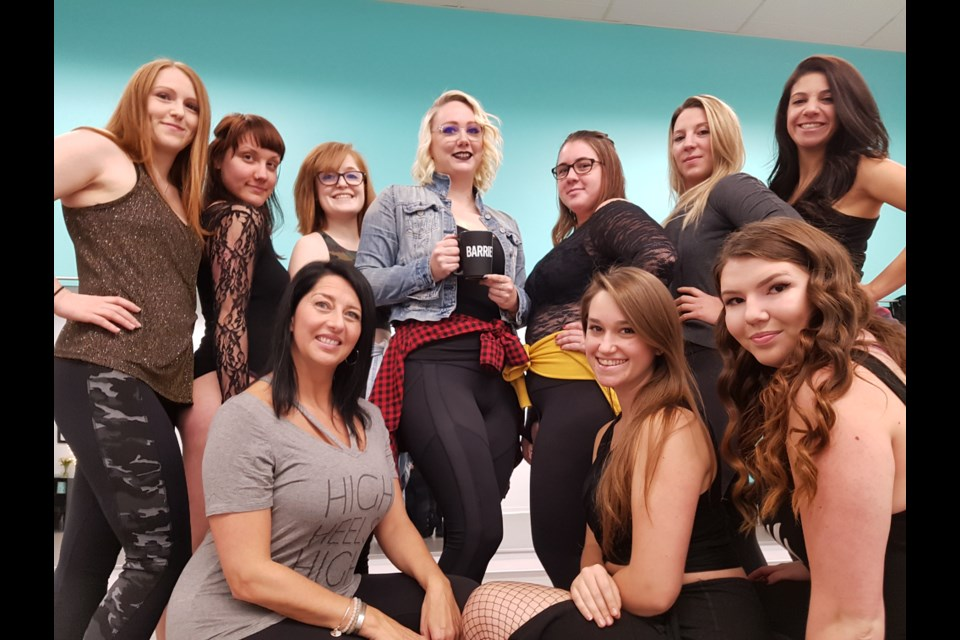 Wendy Graham (holding mug) is surrounded by her Army of Sass class. Shawn Gibson/BarrieToday