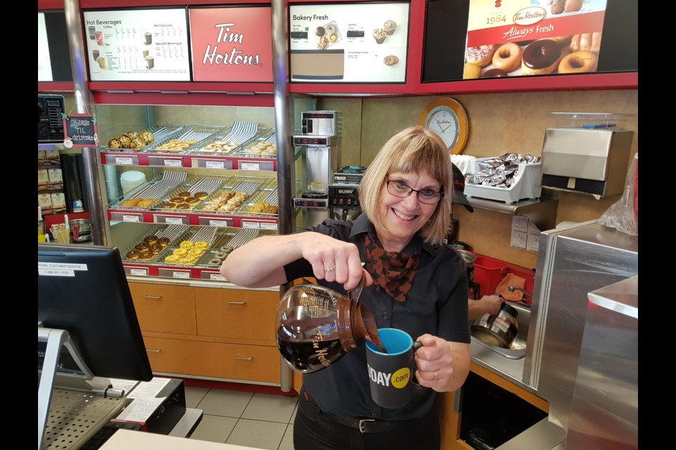 Marlene Drysdale pours a cup of coffee in her new BarrieToday mug with her famous welcoming smile. Shawn Gibson/BarrieToday
