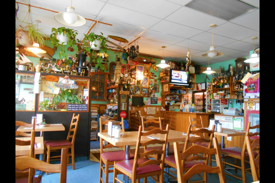A lifetime of collectibles cover the interior of Fil's Cafe. Barrie Historical Archive photo