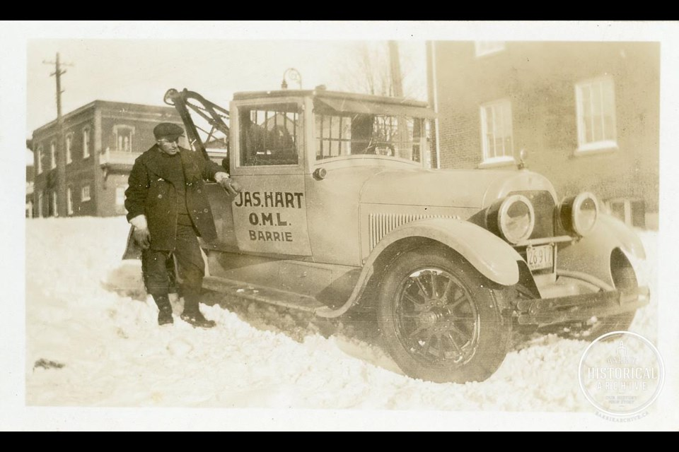 The first photo is of a James W. Hart Garage tow truck driver in 1928, Photo courtesy of Barrie Historical Archive.
