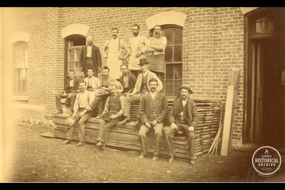 Workers sitting in front of Ball Planing Mill. circa 1890. Photo courtesy of the Barrie Historical Archive.