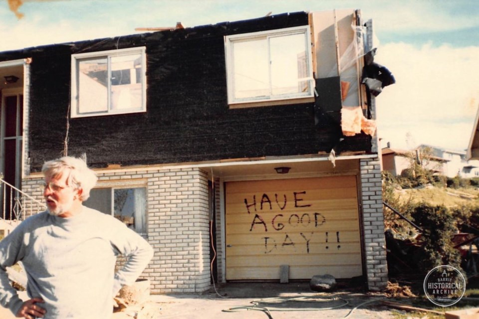 Terry Paddison in front of his heavily damaged Innisfil Street home. Barrie Historical Archive