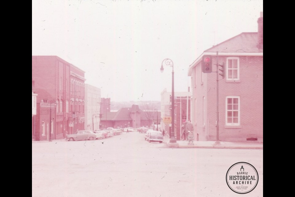 A sliver of 47 Collier St. is just visible on the far left of this 1960 photo showing the train station at the foot of Owen Street. Photo courtesy of the Barrie Historical Archive