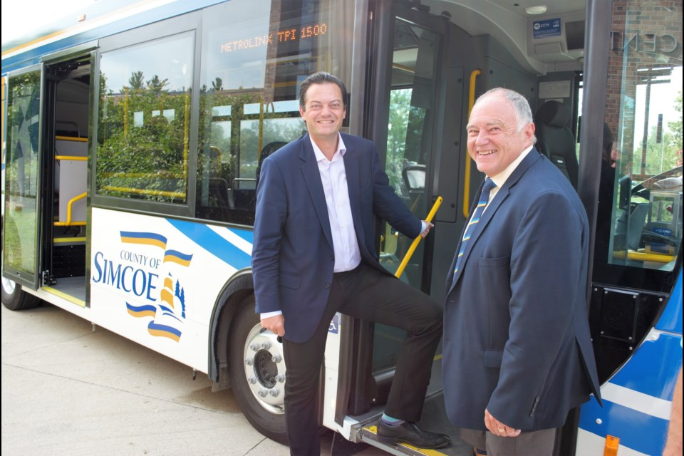 Barrie Mayor Jeff Lehman and County of Simcoe Warden George Cornell step onboard a LINX bus during an event celebrating the newest LINX transit routes at the County of Simcoe administration building on Aug. 13, 2019. Jessica Owen/BarrieToday