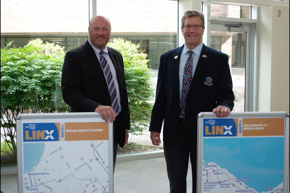 From left, Collingwood Deputy Mayor Keith Hull and Mayor Brian Saunderson show off the two new routes that will impact Collingwood residents the most. Jessica Owen/CollingwoodToday