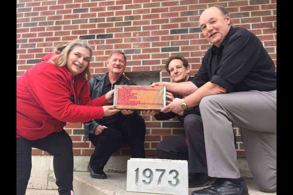 Pictured with the time capsule from left to right are former student Nancy Dickey, former  teacher John Kraft, alumnist and current principal Greg Brucker, and alumnist Jeff Walther.  Sue Sgambati/BarrieToday