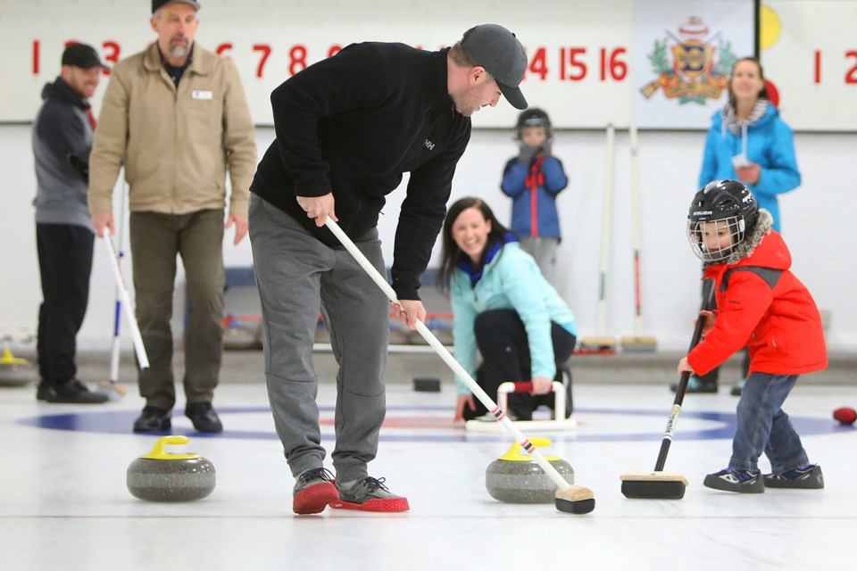 Jordan Barber and 4-year-old son Evan Barber try their best to