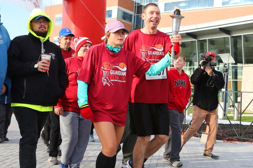 Special Olympians carry the torch at the start of the Guardians Half Marathon in Orillia on Sunday, October 14, 2018. Kevin Lamb for OrilliaMatters.