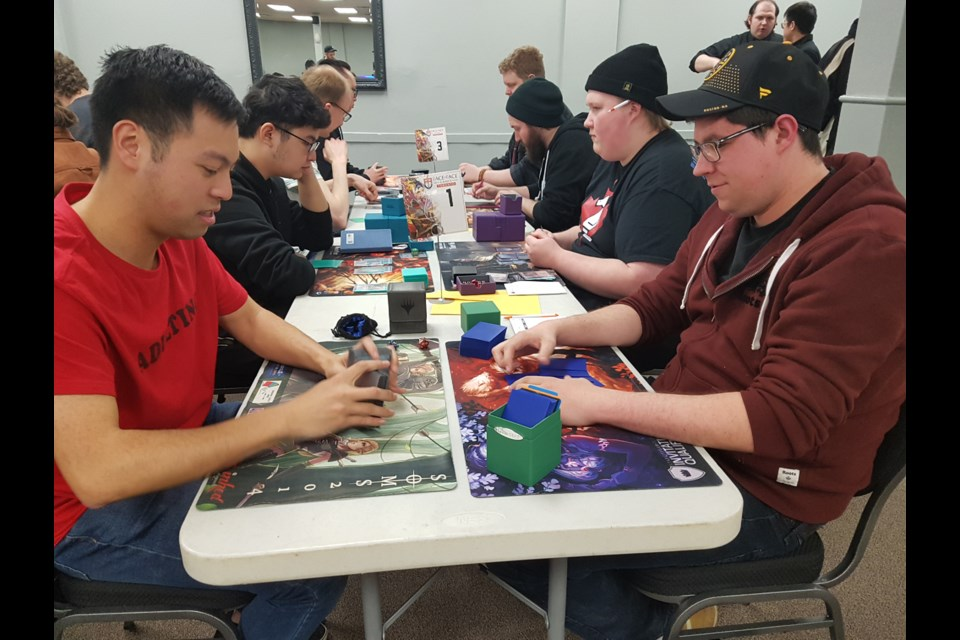 Caleb Keong (left) and Dan Scott (right) get ready to battle in the Magic tournament. Shawn Gibson/BarrieToday