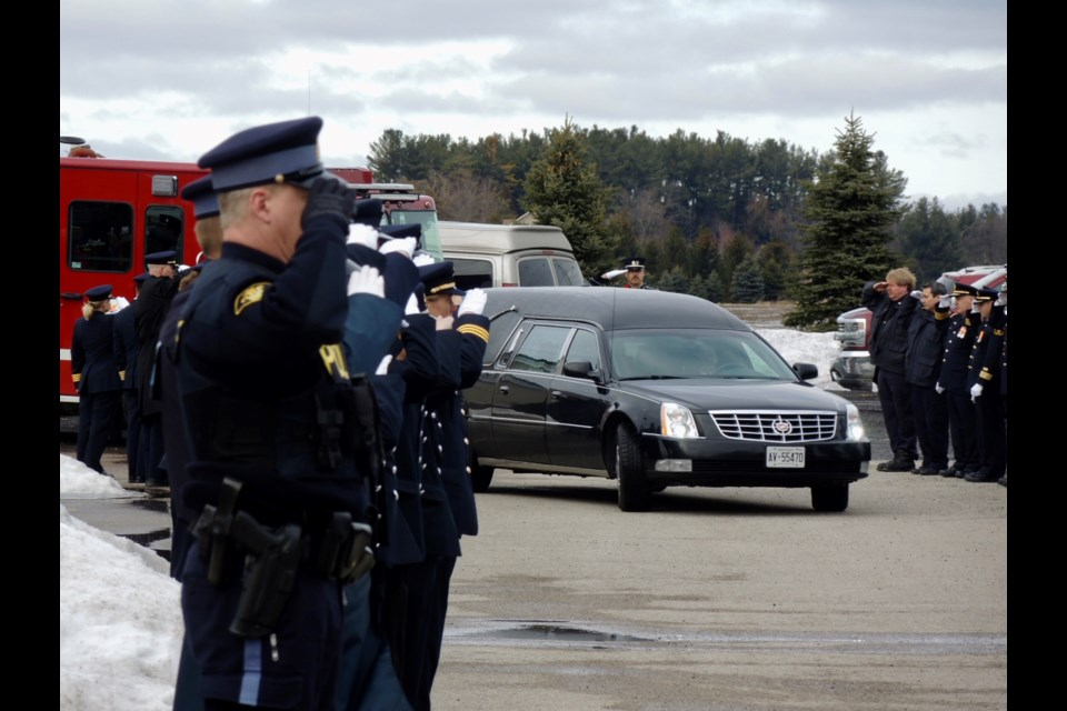 Mourners salute Terry 'Weapon' Weatherup following his funeral service in Baxter.   Sue Sgambati/BarrieToday