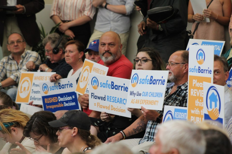 Several members of the new group Safe Barrie were in attendance at city council on Monday, June 24, 2019 carrying signs showing their opposition to a proposed safe injection site in downtown Barrie. Raymond Bowe/BarrieToday
