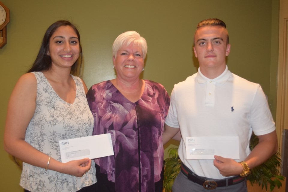 Lise McCourt, president of the RVH Auxiliary presented a $1,000 scholarship to RVH volunteers Ramneet Kaloti, a student at Innisdale Secondary School, and Cameron Weatherill, a Bear Creek Secondary School student. Supplied photo