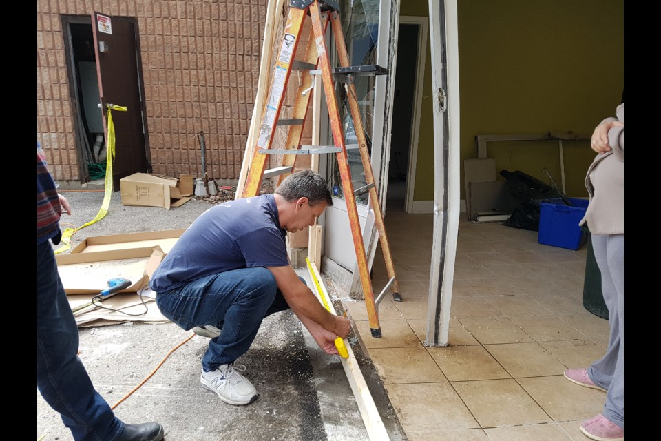 Hope City Church pastor Kevin Mast and his team were hard at work Saturday repairing the damage done by a pick-up truck, May 18 2019. Shawn Gibson/BarrieToday