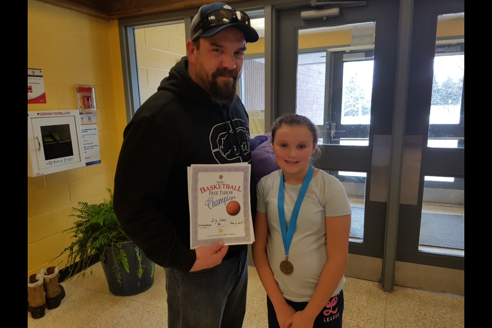 Winner Lily Coles stands with proud dad, Kayne, after Sunday's competition in Barrie. Shawn Gibson/BarrieToday