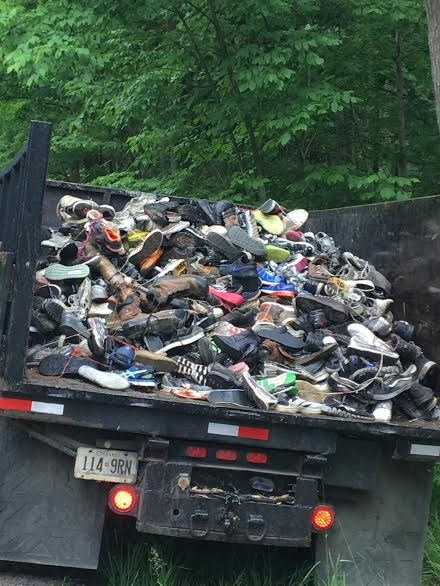 1.2 tonnes of shoes were removed from the 'Shoe Tree' on Crossland Rd. in Springwater Township.