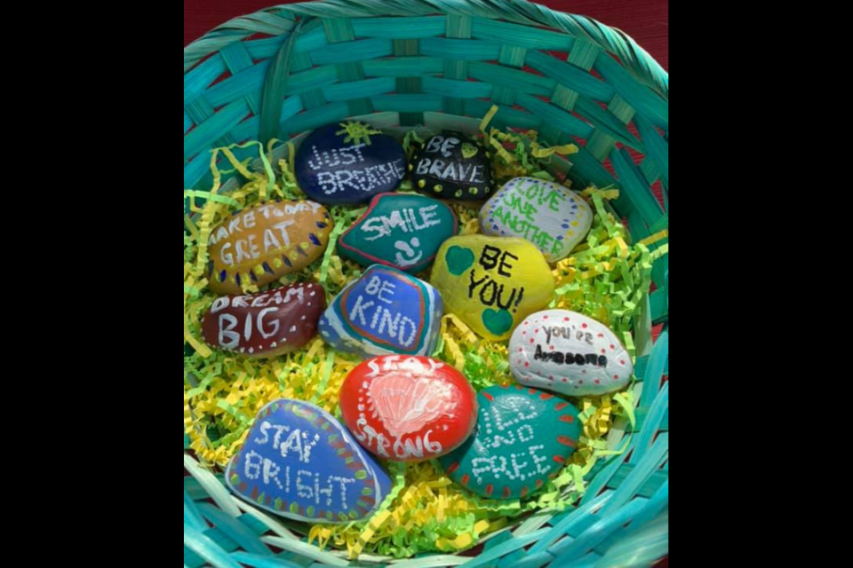 An assortment of brightly painted rocks with positive messages that are part of the Barrie Rocks group on Facebook. Photo supplied