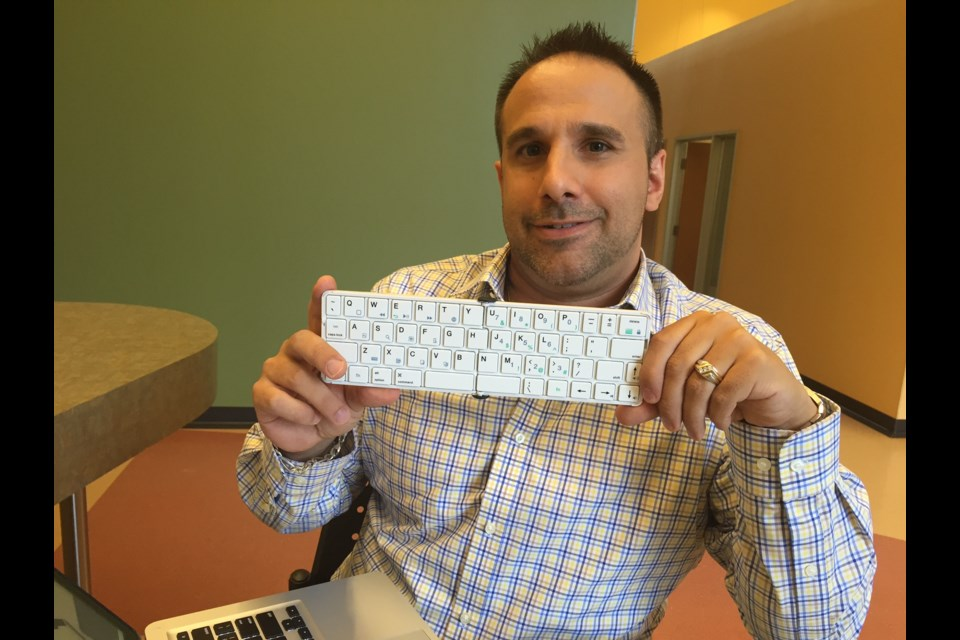 Randy Micallef holds The Goby pocket keyboard. 