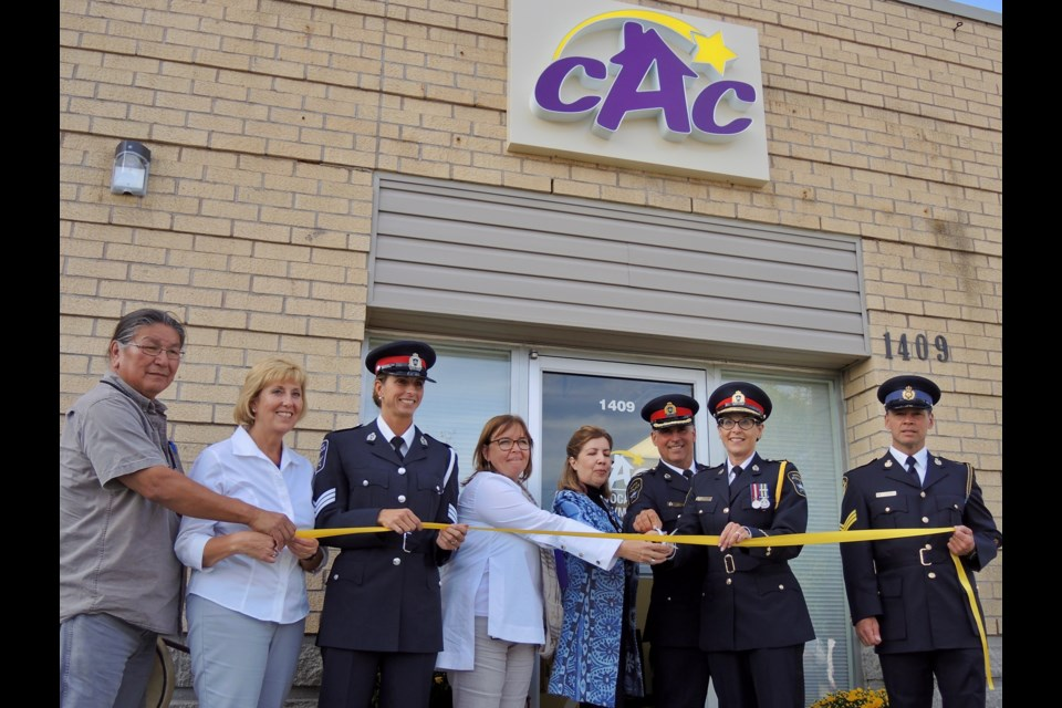 Ribbon cutting to mark the grand opening of a new Barrie Centre for children and youth to disclose abuse.