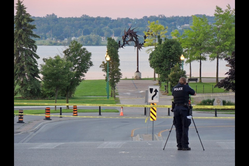 Forensic Identification officer Shannon Green photographs the scene of a shooting in downtown Barrie. Sue Sgambati/BarrieToday