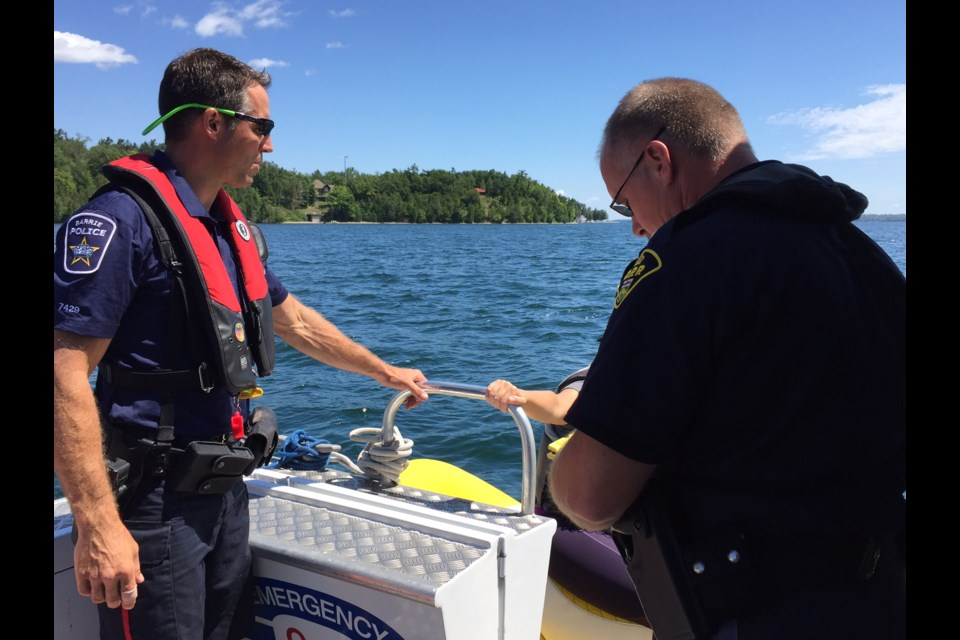 Barrie Police Const. Kurt Hemington and OPP Const. Clark Putman of the joint forces  Marine Unit are on the water this weekend to ensure people boat sober. 