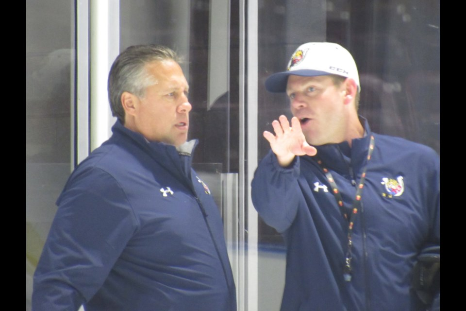 Barrie Colts assistant coach Todd Miller (right) shares some thoughts on the team at practice today after new head coach Warren Rychel (left) was announced by the team. Shawn Gibson/BarrieToday