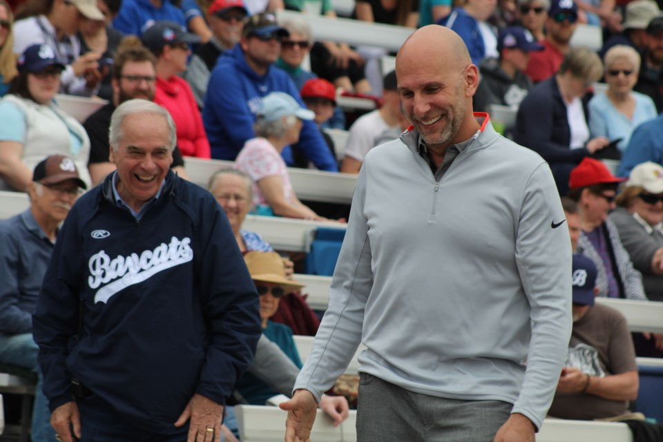 Barrie Baycats president David Mills, left, shares a laugh with ESPN's Dan Shulman, who was on hand to throw out the ceremonial first pitch between Barrie and the Kitchener Panthers during Intercounty Baseball League action on May 18, 2019 at Coates Stadium. Shulman was on hand to call the game with his son, Ben. Raymond Bowe/BarrieToday