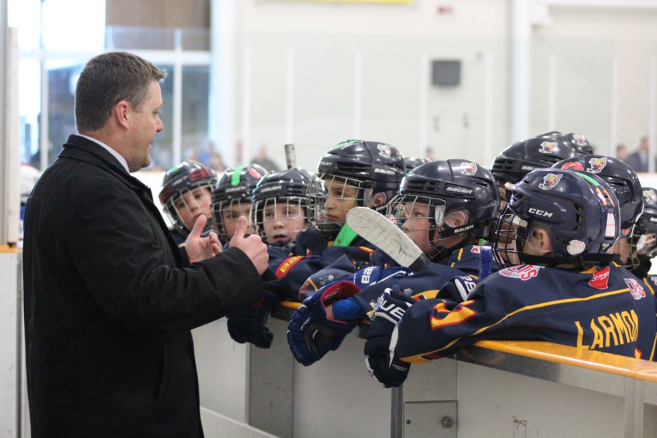 Members of the Barrie Colts atom 'AAA' team listen to instructions from their coach during the OMHA Championship tournament against the Oakville Rangers at Holly Community Centre in Barrie on March 16, 2019. Raymond Bowe/BarrieToday