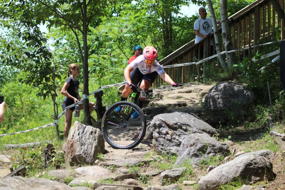 A rider takes a heavy fall on the boneshaker. Hardwood Ski and Bike, located south of Orillia in Oro-Medonte Township, hosted the 2019 Canadian XCO MTB Championships on Saturday, July 20, 2019. Raymond Bowe/BarrieToday