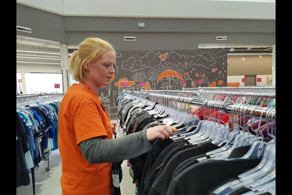 Heather Duffy gets the Talize racks ready for more shoppers on May 14, 2019. Shawn Gibson/BarrieToday