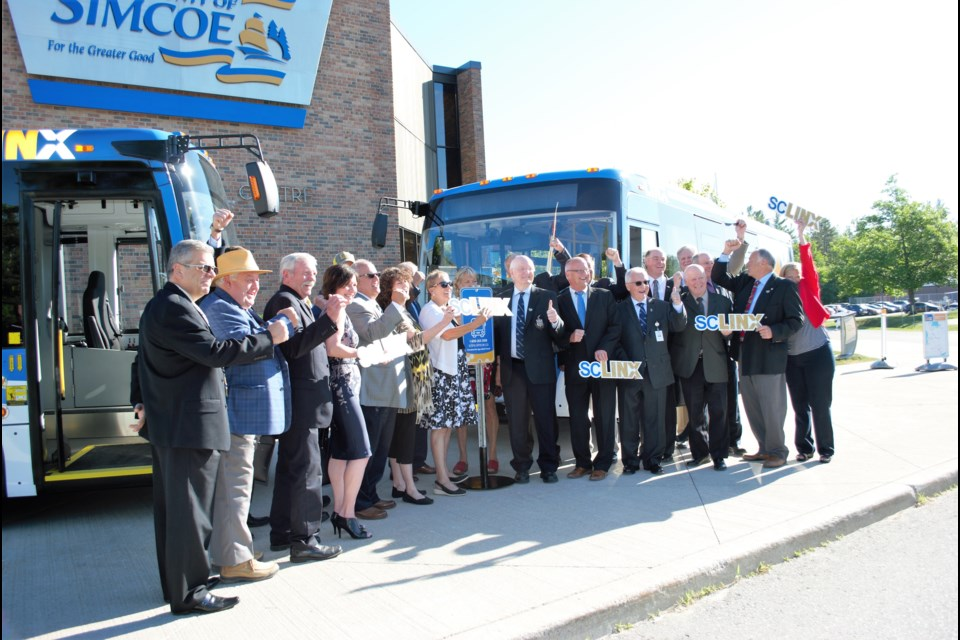 County councillors celebrate the unveiling of the new buses for the Simcoe County Transit LINX. Jessica Owen/ BarrieToday