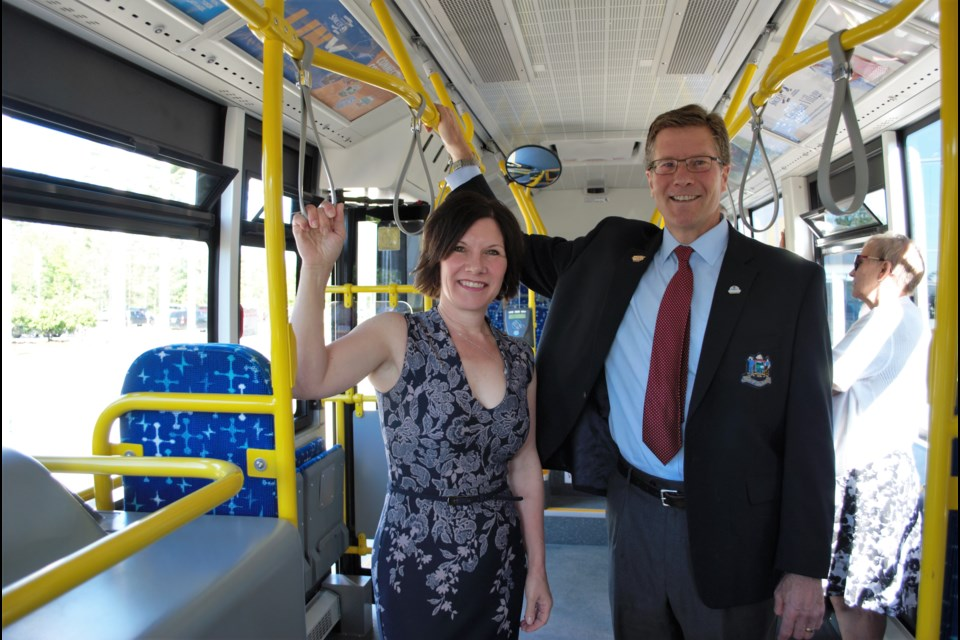 Wasaga Beach Deputy Mayor Nina Bifolchi and Collingwood Deputy Mayor Brian Saunderson test out one of the new transit buses on Tuesday. Jessica Owen/Barrie Today